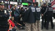 POLICE ARRESTING CLIMATE ACTIVISTS AT TIMES SQUARE