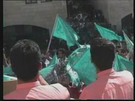 WEST BANK: HAMAS SUPPORTERS BURN ISRAELI FLAG